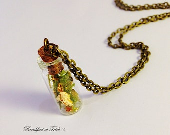 Gold leaf and moss in glass bottle 24k
