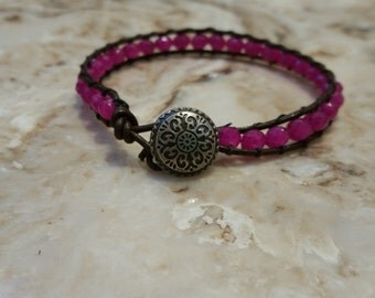 Leather beaded bracelet w/ magenta glass beads