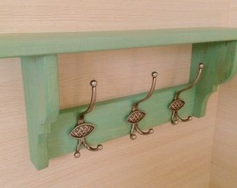 Solid wood shelf with hooks