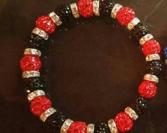 Support your fire fighters with a red and black shamballa bracelet.