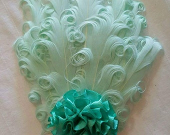 Teal feather clip