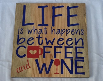 """Wooden """"life is what happens between coffee and wine"""" sign"""