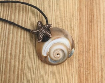 Snail shell necklace with starfish charm