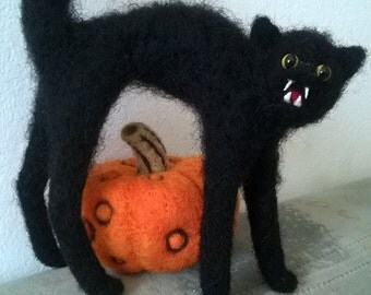Needle felted Halloween black cat with a pumpkin