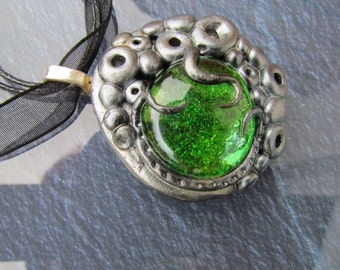 Magical pendant in antiqued silver with green stone #029