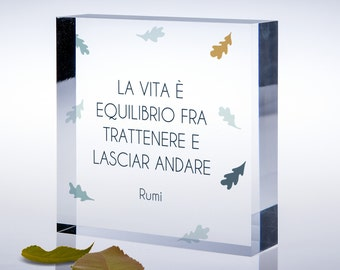 Molded plexiglass cube with aphorism of Rumi