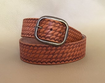 "Saddle tan leather belt embossed with a basketweave design 1 1/2"" wide size 32"" hot waxed edges"