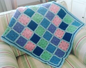 Lovely pastel coloured crocheted blanket, throw