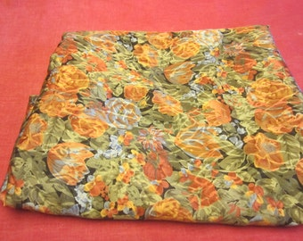 Three and three quarter yards 44 inch wide Synthetic silky fabric with orange and yellow flowers.