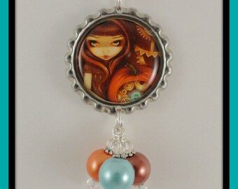 """Jasmine Becket-Griffith """" A Clockwork Pumpkin"""" bottle cap necklace"""