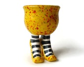 Yellow Sex Pot with High Heels and Striped Stockings