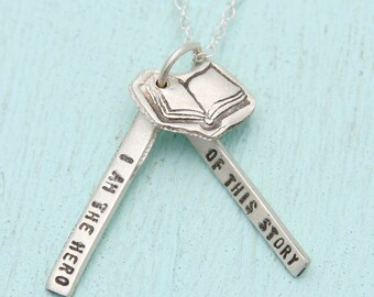 """BOOK charm and quote necklace, """"I am the HERO of this story."""" eco-friendly silver. Handcrafted by Chocolate and Steel"""