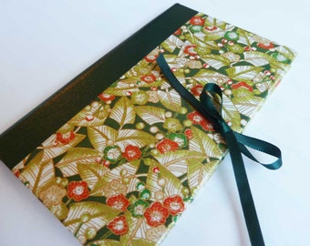 Handbound Journal featuring green Japanese chiyogami covers