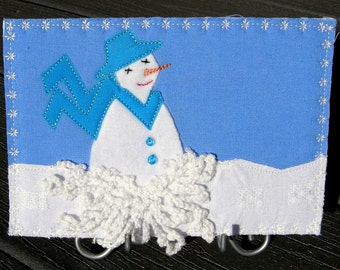 Fabric Postcard Winter Snowstorm, Snowman, Quit Postcard, Winter Landscape, White, Snowman with Aqua Teal Hat and scarf