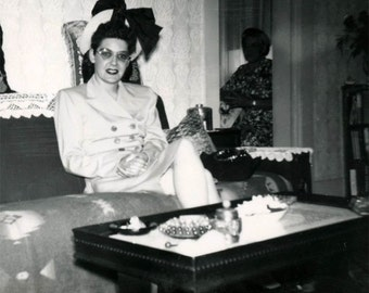 vintage photo 1947 Woman Sits on couch mid century Hidden Mother in Room