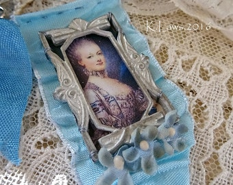 blue Marie Antoinette pin thingy - display or to wear - NO284