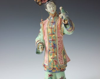 Vintage Chinese figurine - Gentleman in a robe with a bird -  Asian home decor - collectible
