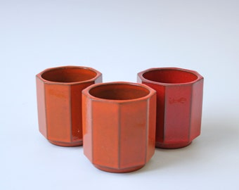 3 small orange tangerine pottery cups -  W Germany tea cups