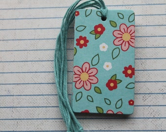 28 pretty pink, white, red flowers on turquoise paper over chipboard gift tags