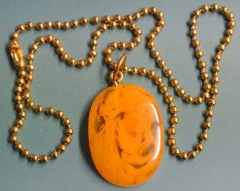 Pendant necklace with genuine tested vintage 1950s swirled yellow tested bakelite plastic bead and brass ball chain