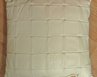 Unusual one-of-a-kind new/unused pillow of creame white skin/  leather in checkered pattern, alike at both sides