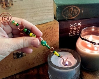 candle snuffer in hammered copper with green and yellow glass beads
