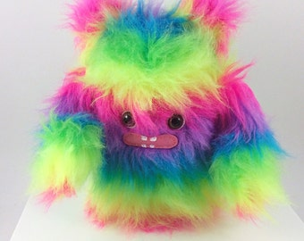 Fuzzy Rainbow Plush Monster