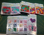 Babyville supplies including 9 pks snaps and 6 pks of Labels / Applique patches