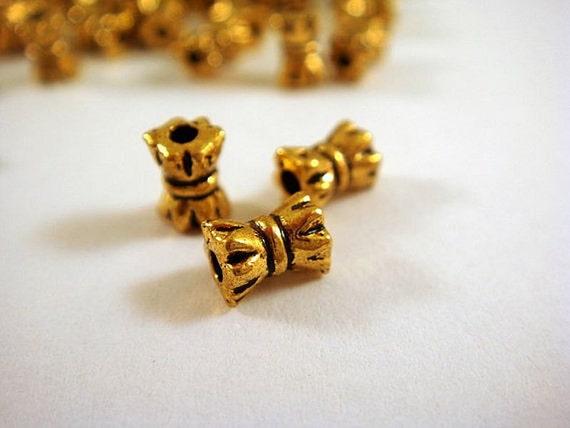 50 Gold Spacer Bead Bowtie 5mm Antique Tibetan Style 5x4mm - 50 pc - M7005-AG5x4mm50