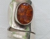 Large adjustable sterling silver and amber wrap ring
