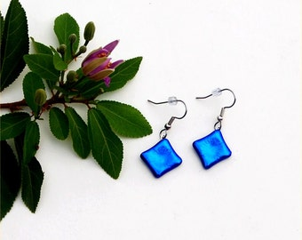 131 Fused dichroic glass blue squares.
