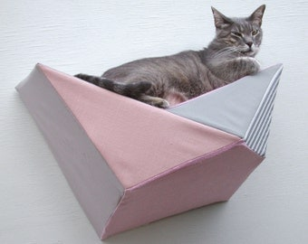 Geometric cat shelf wall bed in pink, peach, pale taupe & grey stripes