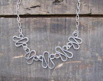 Squiggle link necklace by teresamatheson