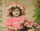 1900s French postcard, Edwardian girl in pink dress, RPPC, paper ephemera.