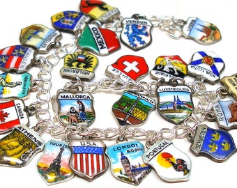"Travel Charm bracelet, Sterling silver with 25 enamel shields, 8"". Fully loaded."