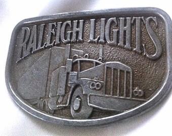 Vintage Raleigh Lights Belt Buckle Semi Truck Big Rig Brass Buckle . 1970's Raleigh Cigarettes  . 70s Raleigh Lights 18 Wheeler Trucker Gift