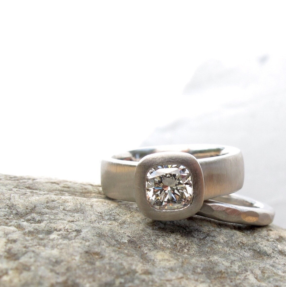 cushion cut engagement ring wide band ring with bezel