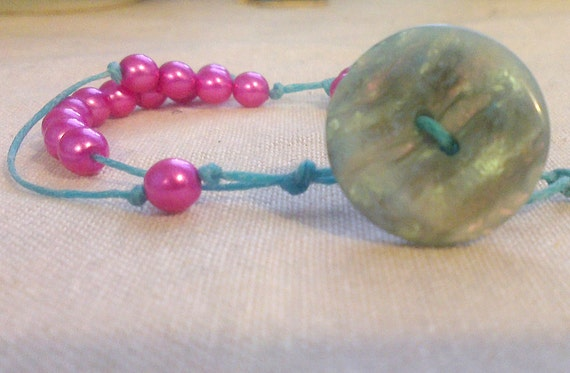 Pink and turquoise math sciart bracelet with digits of pi, perfect for math teachers and grads.