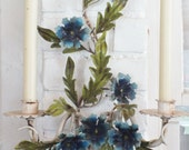 Italian tole-ware with blue flowers green leaves and two candle holders in a mid century French Cottage Chic design