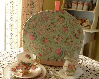 Simply Sheila tea cozy light green with pinks hearts