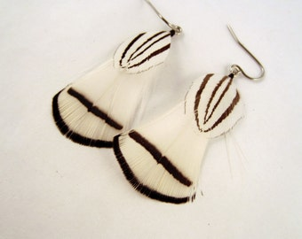 White Feather Earrings with a touch silver