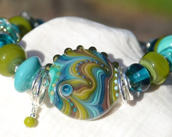 Reserve for Cheryl-MOSSY MEADOWS-Handmade Lampwork and Sterling Silver Bracelet