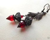 Vintage inspired dangle earrings with dark filigree and red Czech glass