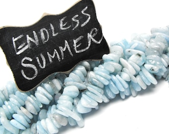 AQUAMARINE PEBBLES 00474 precious gemstone flat tumbled polished drilled pale blue beryl trtd baby blue color beachy bead 16 in strand