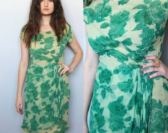 in the garden eternally -- vintage 1950s mad men green floral wiggle dress M