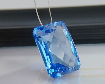 Blue Topaz Checker Faceted Emerald Cut