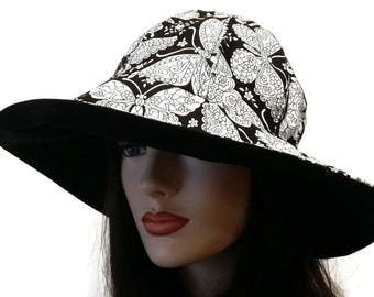 Reversible Wide Brim Sun Hat in black and white butterfly print with adjust fit plus chinstrap for boating/convertibles/windy days