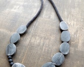 Charcoal grey oval beads combined with matching crochet tubes for this necklace