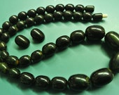 Collectible vintage 1950s unused tested graduated opaque very dark forest green tested bakelite necklace w oval beads and matching earclips