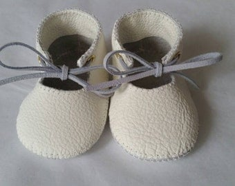 White leather baby shoes.